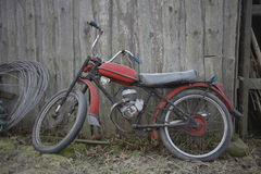 Motorcycle. Old motorcycle left to the barn Royalty Free Stock Images