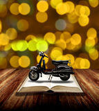 Motorcycle on open book, Travel with motobike story Royalty Free Stock Image