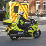 Motorcycle paramedic and ambulance at scene of an  Royalty Free Stock Photography
