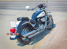 Motorcycle is parked on asphalted road Royalty Free Stock Images