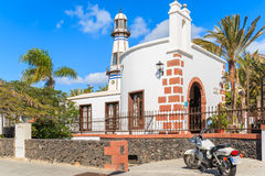 Motorcycle parked in front of typical church Stock Images