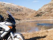 Motorcycle parked next to Lake Montespluga Royalty Free Stock Photos