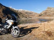 Motorcycle parked next to Lake Montespluga Royalty Free Stock Photo