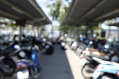 Motorcycle parked at a park Stock Photography
