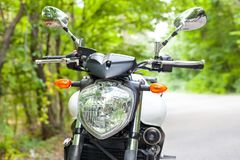 Motorcycle parked on the road Royalty Free Stock Photos
