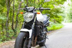 Motorcycle parked on the road Stock Photos