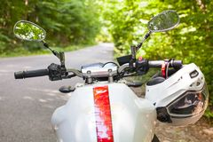 Motorcycle parked on the road Stock Photography