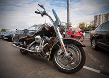 Motorcycle parked on sidewalk Royalty Free Stock Photos