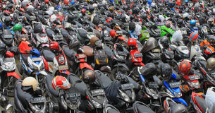 Motorcycle parking full a lot of motor parked outdoor, view on Jakarta Indonesia transportation. Photo royalty free stock photo
