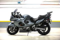 Motorcycle parking in garage. Photo of a Motorcycle parking in garage Royalty Free Stock Photos