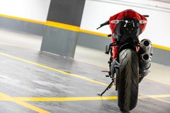 Motorcycle parking in garage. Photo of a Motorcycle parking in garage Royalty Free Stock Images