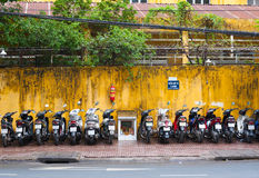 Motorcycle parking lot, Saigon. HO CHI MINH, VIETNAM - JULY 5, 2014: A view at a parking lot full of motorcycles at Pham Ngu Lao Street. 99 per cent of all city Stock Photography