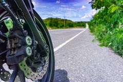 Motorcycle parking on the road. Focus on Tyre Royalty Free Stock Photography