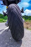 Motorcycle parking on the road. Focus on tyre Royalty Free Stock Image
