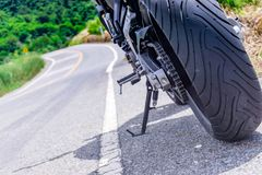 Motorcycle parking on the road. Focus on tyre Stock Photo