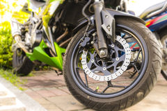 Motorcycle. Parking , Selective focus on front wheel Royalty Free Stock Photo