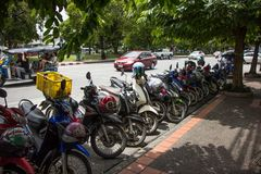 Motorcycle Parking side city road. Chiangmai, Thailand - August 10 2018: Motorcycle Parking side city road. Photo on road in chiangmai city stock photo