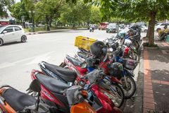 Motorcycle Parking side city road. Chiangmai, Thailand - August 10 2018: Motorcycle Parking side city road. Photo on road in chiangmai city royalty free stock images