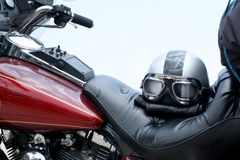 Motorcycle. Part of a Harley-Davidson motorcycle with helmet on the seat Royalty Free Stock Photos