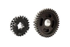 Motorcycle part. Old metal gear wheel or pinion part , Motorcycle Gear driven gear reduction ratio  isolated on white background. Motorcycle part. Old metal gear stock photography