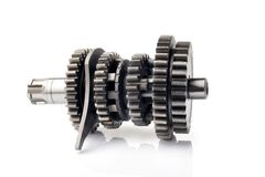 Motorcycle part. Old metal gear wheel or pinion part , Motorcycle Gear driven gear reduction ratio  isolated on white background. Motorcycle part. Old metal gear royalty free stock photo