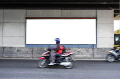 Motorcycle Passing Through Billboard Royalty Free Stock Images