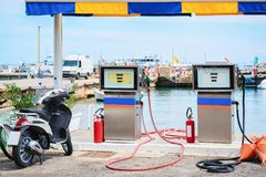 Motorcycle at petrol station for filling ships Cefalu port Sicily. Motorcycle at petrol station for filling ships at Cefalu port, Palermo region, Sicily island royalty free stock image