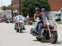 Motorcycle Poker Run People smiling. Motorcycle riders smiling as they leave a small town bar during a charity event stock images