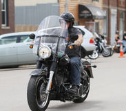 Motorcycle Poker Run Rider leaving Stock Photo