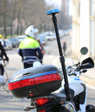 Motorcycle police with flashing siren and a traffic officer on t. He road stock photography