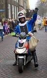 Motorcycle policeman dressed in costume waving Stock Image