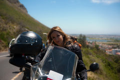 A motorcycle portrait of a beautiful woman. Royalty Free Stock Photography