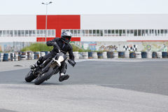 Motorcycle practice leaning into a fast corner on track Stock Photography