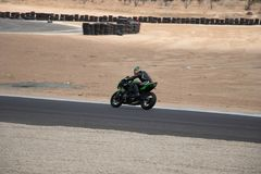 Motorcycle on a race track on a training day b.b. Motorcycle competition on a race track on a training day b.b royalty free stock image
