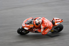 Motorcycle racer in action Stock Photos