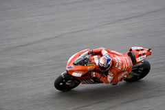 Motorcycle racer in action Royalty Free Stock Image