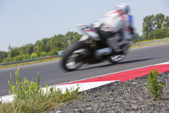 Motorcycle racer on circuit Stock Photography