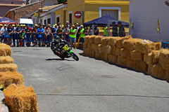 Motorcycle Racer. Coming out of a corner during the Algueña motorcycle road race in Spain stock photos