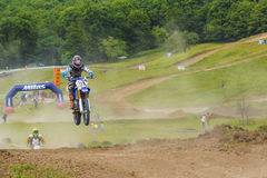 Motorcycle racer jumping Stock Photography