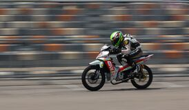 Motorcycle Racer on Silver Motorcycle Royalty Free Stock Photo