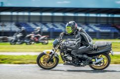 Motorcycle racer on sportbike leaning into a fast corner on track.  royalty free stock photos