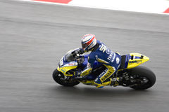 Motorcycle racer on track Stock Photos