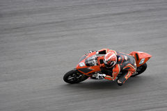 Motorcycle racer on track Stock Image