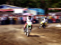 Motorcycle racers. A view of two motorcycle racers turning a racetrack corner at full speed stock photo