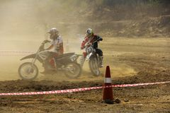 PUNE, MAHARASHTRA, INDIA, February 2018, Motorcycle racers compete with each other during dirt cross motorcycle race. Motorcycle racers during dirt cross stock photos