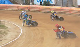Motorcycle racers enter turn Stock Photo