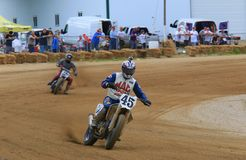 Motorcycle racers. Pro motorcycle rider struggles to catch the race leader royalty free stock photos