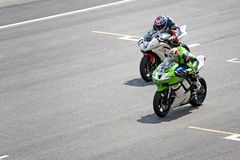 Motorcycle racers on track Royalty Free Stock Images