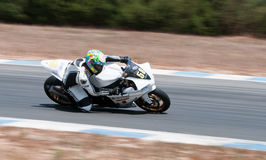 Motorcycle racing. Man riding super speedy motorcycle on the race track during racing competition stock photo