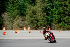 Motorcycle racing. Motorcycle racer leading the pack Stock Photo